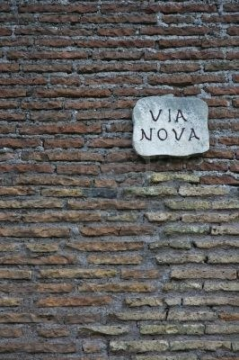 611333-ancient-roman-wall-with-street-nameboard