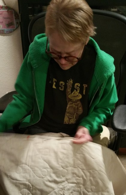 Cozy. Kate finishing a quilt gift for Sandy, who will have surgery again this week