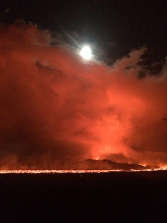 June 28 Night view of the lava channel toward fissure 8 under a nearly full moon.