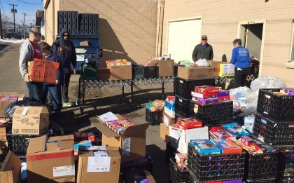 religious school at Jeffco Action Center, packing Thanksgiving meals